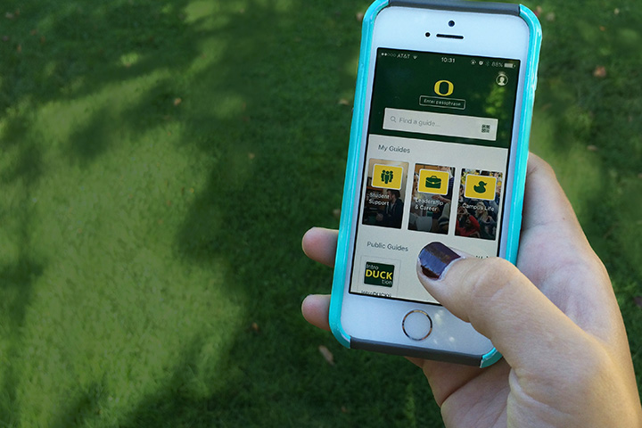 Close up of a hand holding a phone with the Be a Duck app showing on the screen.