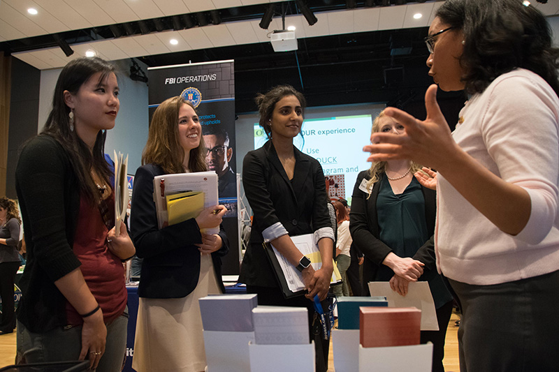 Four students talking to an employer at the Career Fair