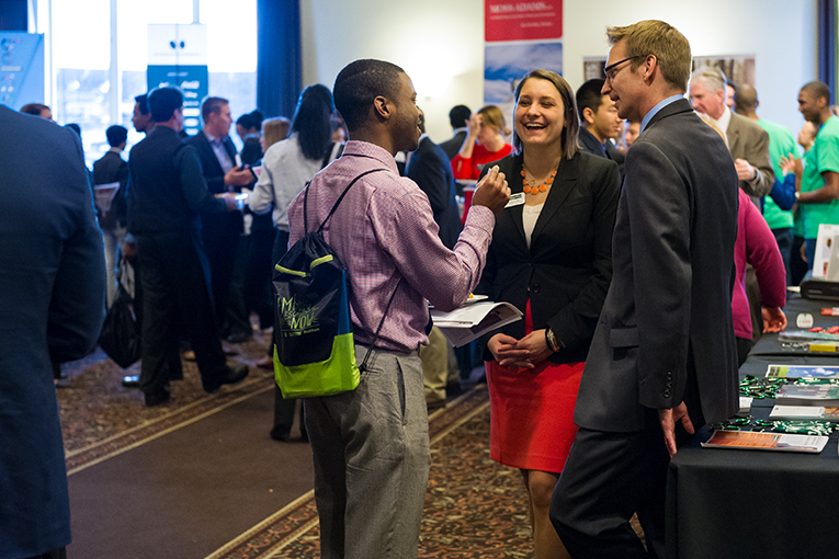 A student visits with employers at the Diversity Career Symposium.